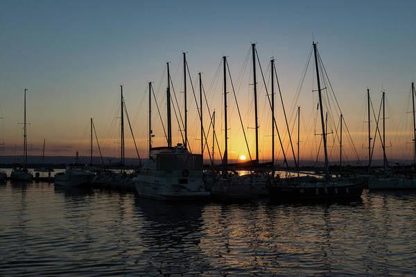 Photograph - Sunset Through The Rigging - Syracuse Sicily Harbor Yachts by Georgia Mizuleva