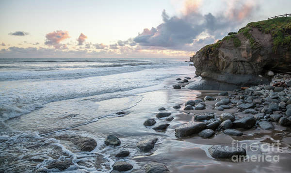 Sunset View In The Distance With Large Rocks On The Beach Art Print