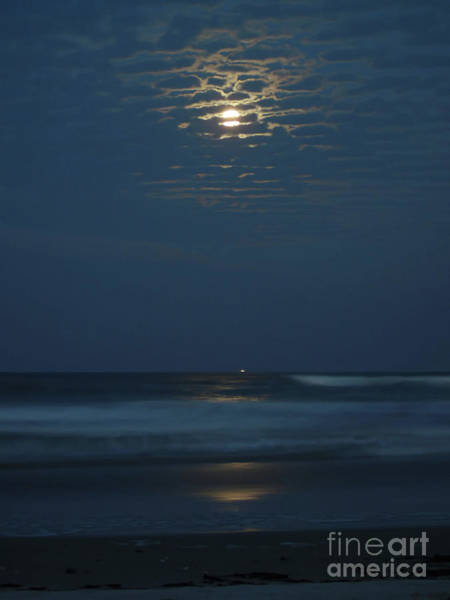 Photograph - Supermoon Between The Clouds by D Hackett