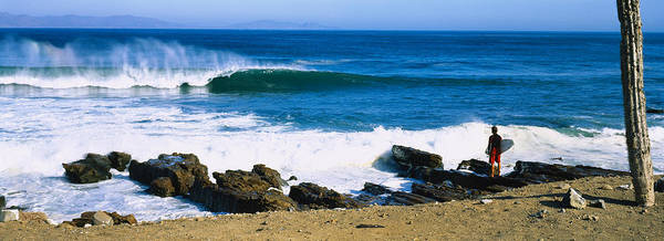 Baja California Peninsula Wall Art - Photograph - Surfer Standing On The Beach by Panoramic Images