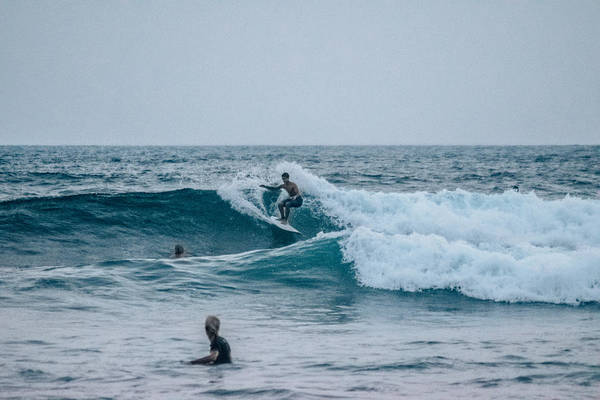 La Libertad Photograph - Surfing by Totto Ponce