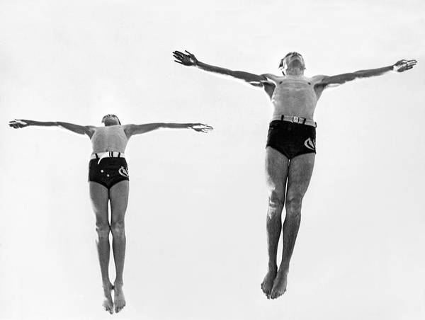 Plunge Photograph - Swan Dive Together by Underwood Archives