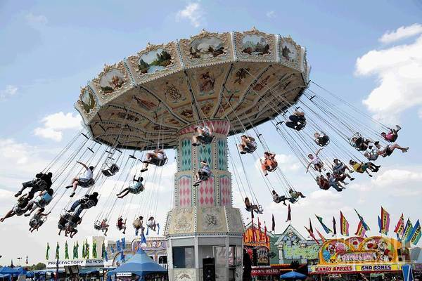 Digital Art - Swing Carousel At A County Fair With Digital Effects by William Kuta