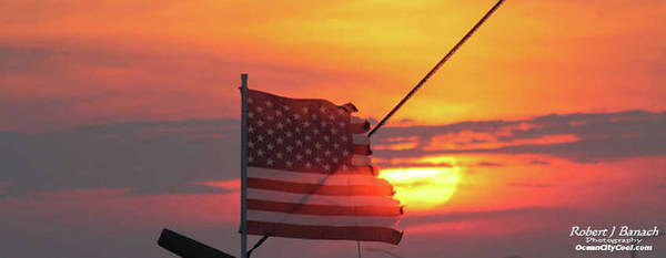 Photograph - Tattered Flag At Sunset by Robert Banach