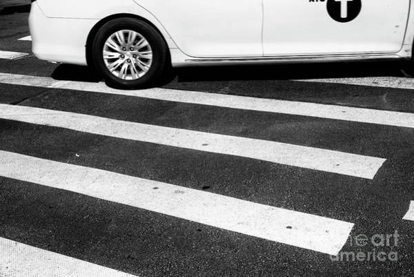 Photograph - Taxi Crossing New York City by John Rizzuto