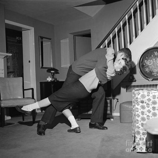 Photograph - Teen Couple Dancing In Living Room by H. Armstrong Roberts/ClassicStock