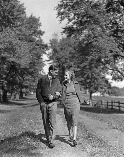 Photograph - Teen Couple Out For A Walk, C.1930-40s by H. Armstrong Roberts/ClassicStock