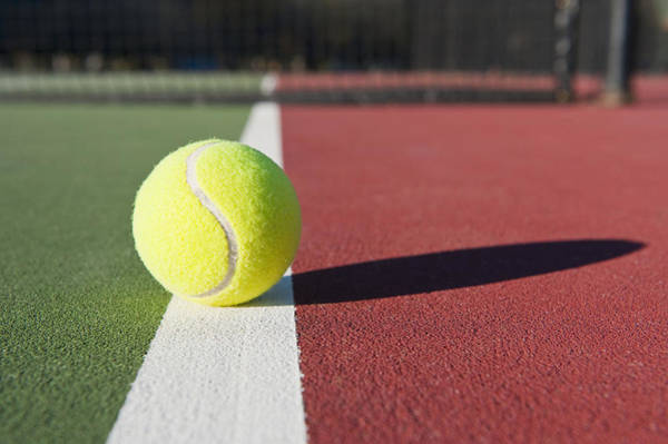 Wall Art - Photograph - Tennis Ball Sitting On Court by Thom Gourley/Flatbread Images, LLC