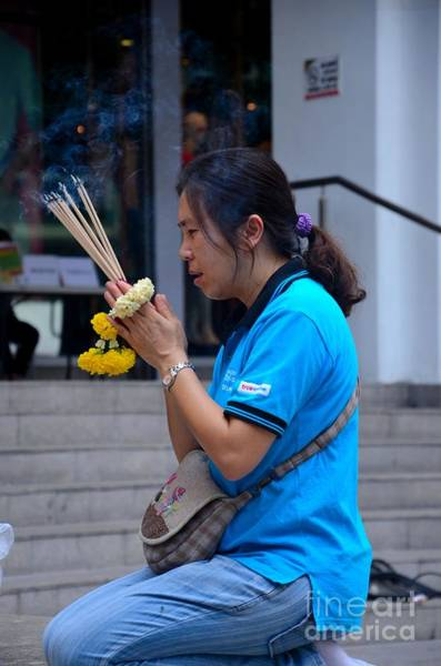 Photograph - Thai Woman Worships And Prays At Outdoor Shrine Altar Bangkok Thailand by Imran Ahmed