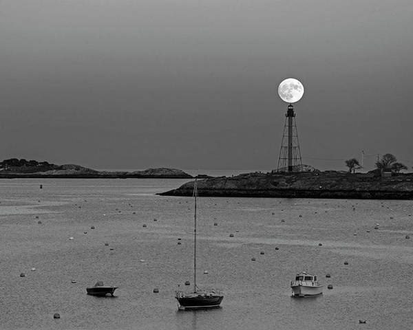 Photograph - The 2016 Supermoon Balancing On The Marblehead Light Tower In Marblehead Ma Black And White by Toby McGuire
