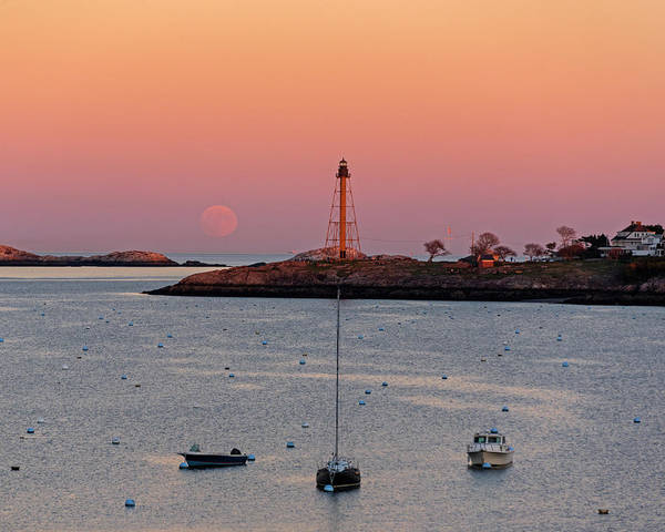 Photograph - The 2016 Supermoon Balancing On The Marblehead Light Tower In Marblehead Ma Harbor Moonrise by Toby McGuire