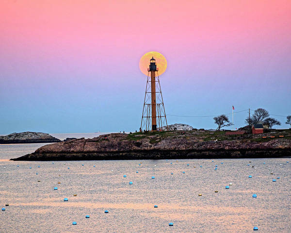Photograph - The 2016 Supermoon Balancing On The Marblehead Light Tower In Marblehead Ma Harbor by Toby McGuire