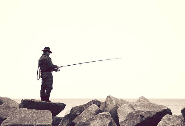 Angling Photograph - The Angler On The Rocks by Heike Hultsch