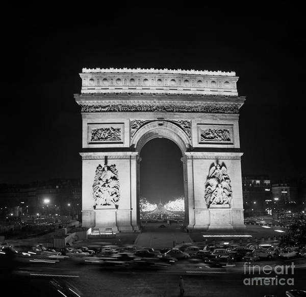 Wall Art - Photograph - The Arc De Triomphe And The Champs-elysees, Paris, At Night 1969 by French School