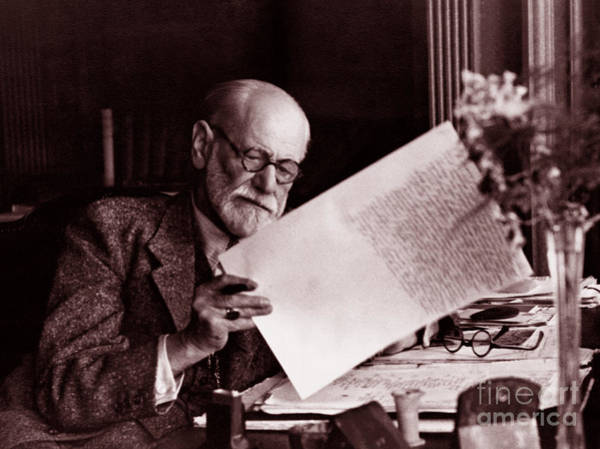 Wall Art - Photograph - The Austrian Neurologist Sigmund Freud At His Desk by Austrian School