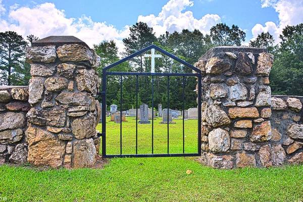Photograph - The Cemetery Gate And Stone Wall by Lisa Wooten