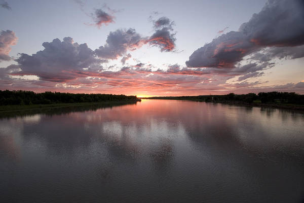North Dakota Photograph - The Missouri River At Sunset Reflects by Phil Schermeister