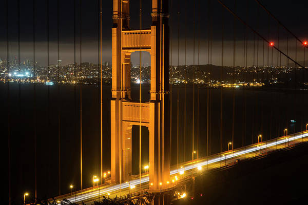 Photograph - The San Francisco Skyline Through The Golden Gate Bridge by Toby McGuire