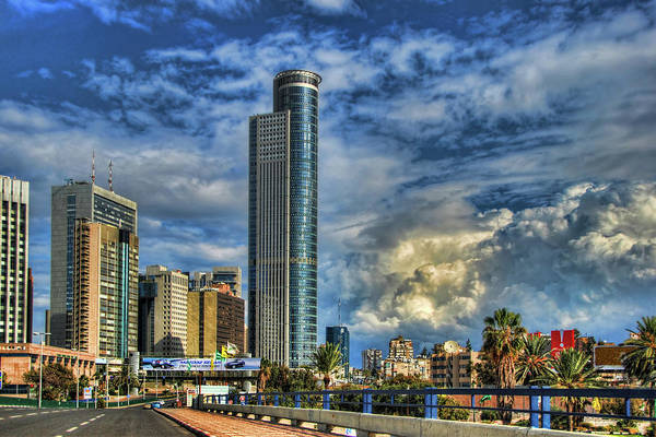 Wall Art - Photograph - The Skyscraper And Low Clouds Dance by Ron Shoshani