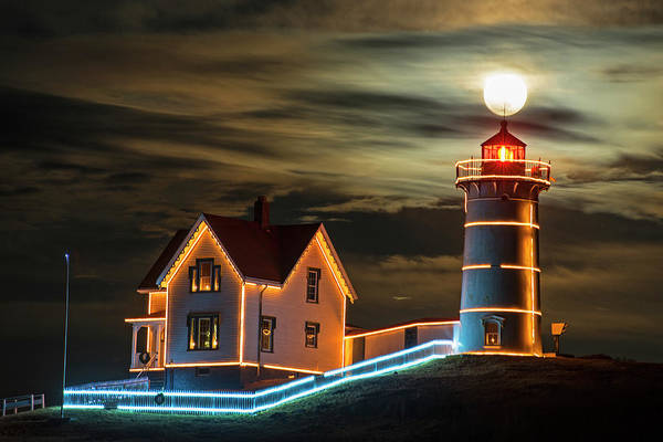 Photograph - The Supermoon Rising Over The Top Of The Nubble Lighthouse York Maine by Toby McGuire