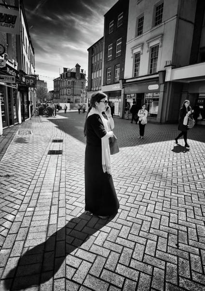 Photograph - The Woman Her Phone And Diagonal Shadow by John Williams