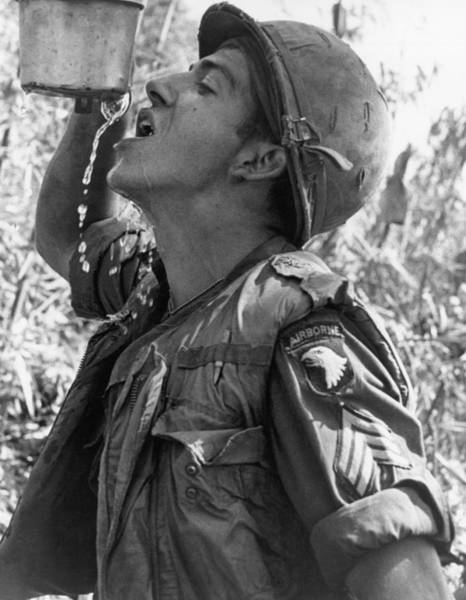 Photograph - Thirsty Vietnam Soldier by Underwood Archives