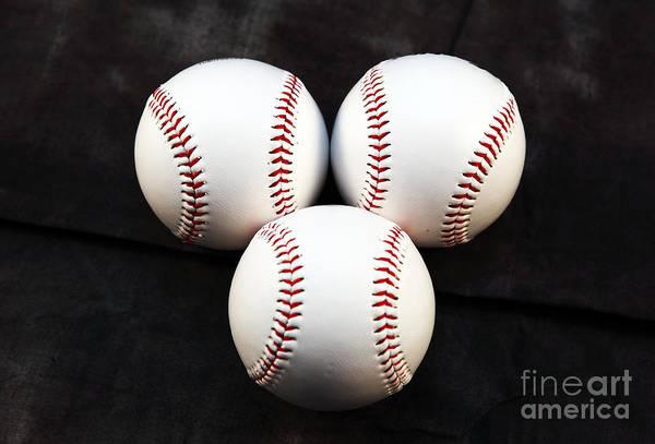 Photograph - Three Balls by John Rizzuto