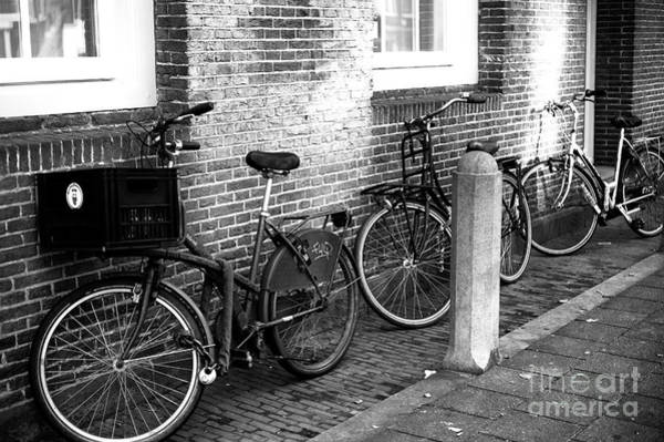 Photograph - Three Bicycles In Amsterdam Mono by John Rizzuto