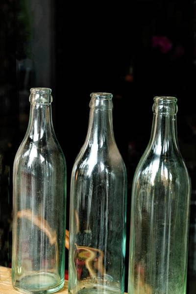 Photograph - Three Bottles by Tom Singleton