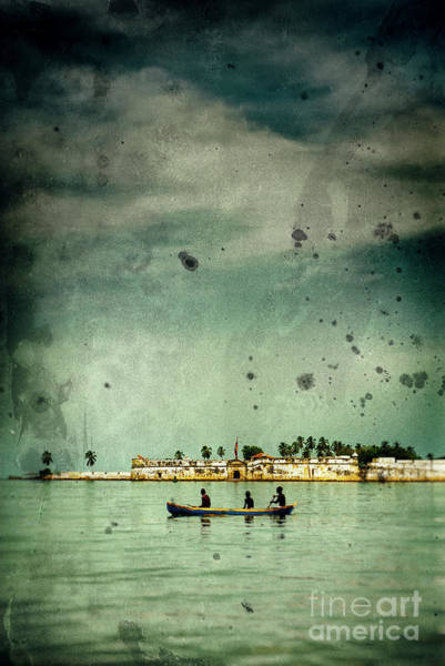 Wall Art - Photograph - Three Boys In A Canoe In The Caribbean Sea by A Cappellari