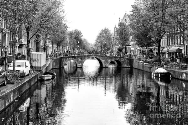 Photograph - Three Circles In The Canal by John Rizzuto