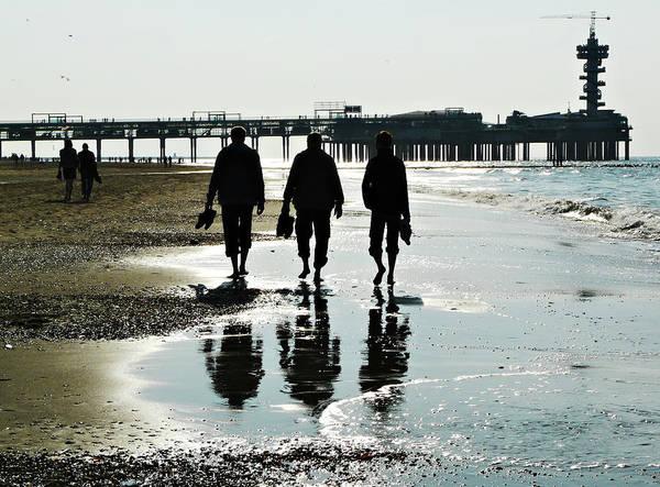 Scheveningen Pier Photograph - Three Guys On A Beach by Lin Van der Heiden