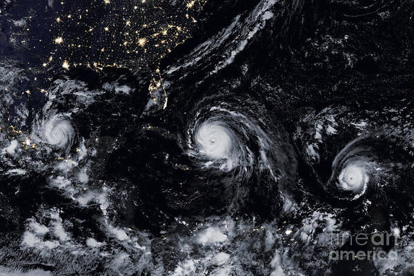 Wall Art - Photograph - Three Hurricanes At Night by Jon Neidert
