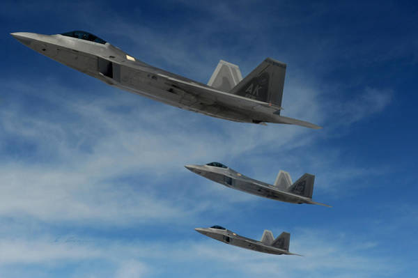 Wall Art - Photograph - Three Lockheed Martin F-22 Raptors On Patrol by L Brown