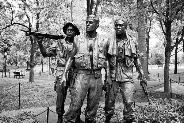 Wall Art - Photograph - Three Soldiers Or Servicemen Statue At The Vietnam Veterans Memorial Washington Dc Usa by Joe Fox