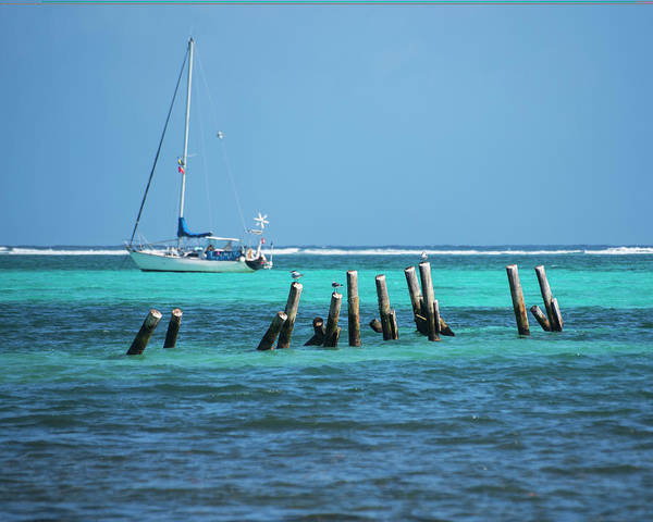Ambergris Caye Photograph - Tilted Pilons Amergris Caye San Pedro Belize Blue Water by Toby McGuire