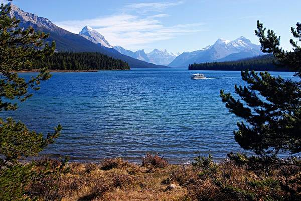 Photograph - Touring Maligne Lake by Larry Ricker