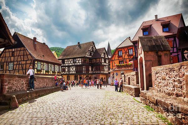 Photograph - tourists on bridge, Alsace village Kaysersberg in Strasbourg reg by Ariadna De Raadt