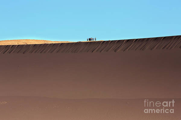 Wall Art - Photograph - Tourists Stand On Top Of A Sand Dune In Valle De La Luna by Louise Heusinkveld