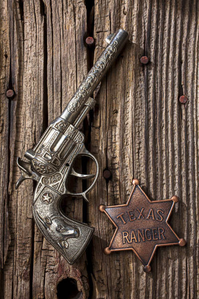 Toy Gun Photograph - Toy Gun And Ranger Badge by Garry Gay