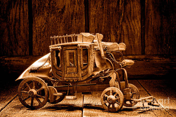 Wall Art - Photograph - Toy Stagecoach - Sepia by Olivier Le Queinec
