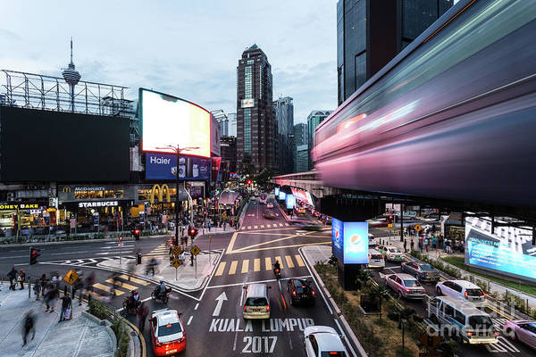 Photograph - Traffic And A Monorail Car Rush Through The Bukit Bintang Inters by Didier Marti