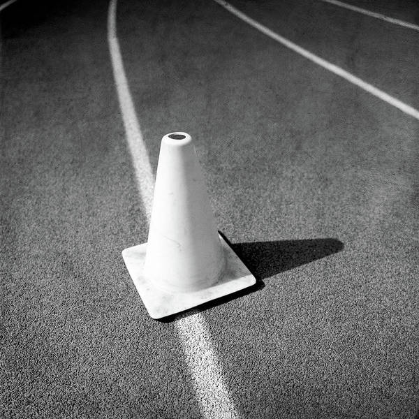 Wall Art - Photograph - Traffic Cone On Runners Track Lanes In Bw by YoPedro