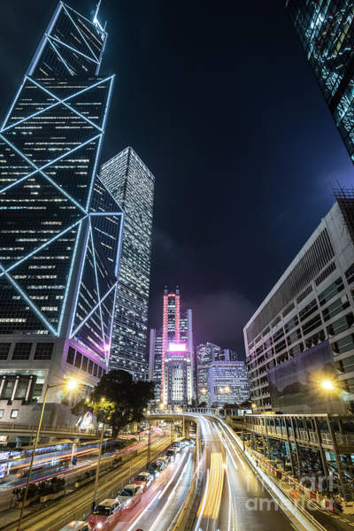 Photograph - Traffic Light Trails In The Heart Of Hong Kong Business District by Didier Marti