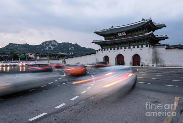 Photograph - Traffic Rushing In Front Of The Gyeongbokgung Palace In Seoul  by Didier Marti