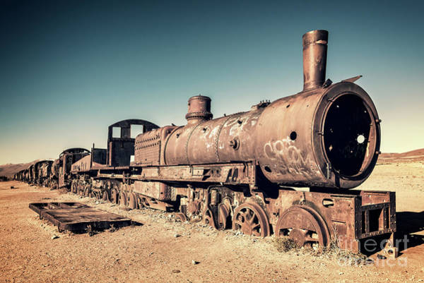 Wall Art - Photograph - Train Cemetery In Uyuni, Bolivia by Delphimages Photo Creations