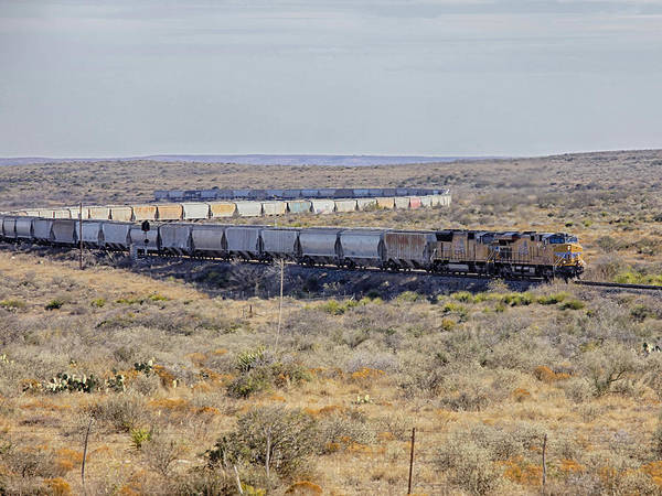 Photograph - Train Snaking Through Desert by Charles McKelroy