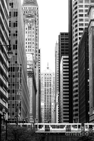 Wall Art - Photograph - Train Through Chicago by John Rizzuto