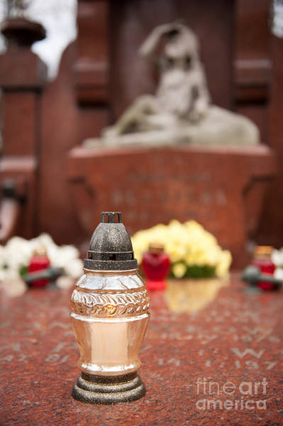 Wall Art - Photograph - Transparent Votive Candle On Grave by Arletta Cwalina
