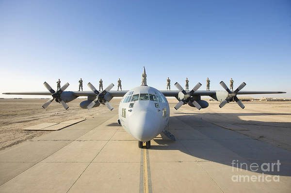 Military Air Base Photograph - Troops Stand On The Wings Of A C-130 by Terry Moore